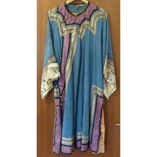 525 - An early 20th Century finely embroidered blue silk Japanese Kimono with circular gilt metal buttons ...