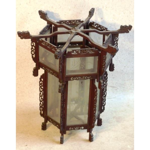 530 - A Chinese carved fretwork and glass sided (etched with flower) hexagonal Lantern, the top with six p...