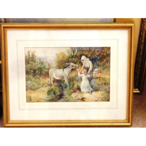 545 - A gilt framed and glazed Watercolour depicting figures before a donkey within countryside surroundin...