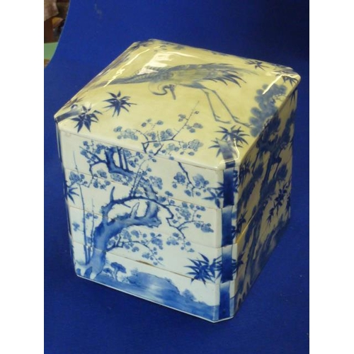 57 - A large and unusual 19th Century Japanese porcelain four segment Storage Tower and Cover, the Cover ...