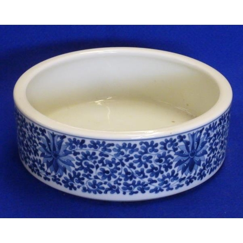 58 - A Chinese circular porcelain Bowl hand decorated in underglaze blue with scrolling lotus (probably m...