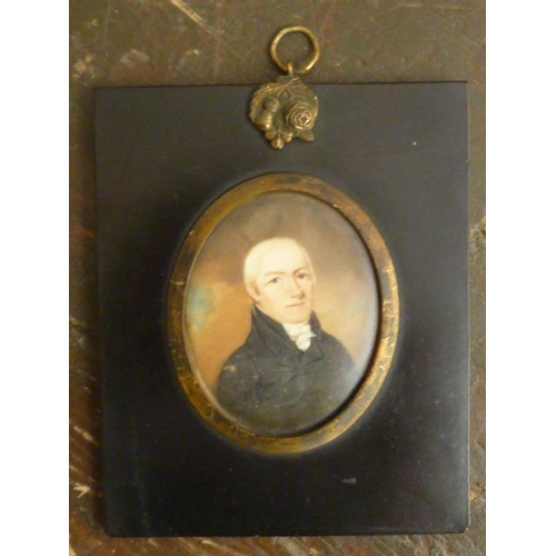 591 - A 19th Century oval shoulder length Portrait Study of a gentleman with chalk blond hair and dark tun...