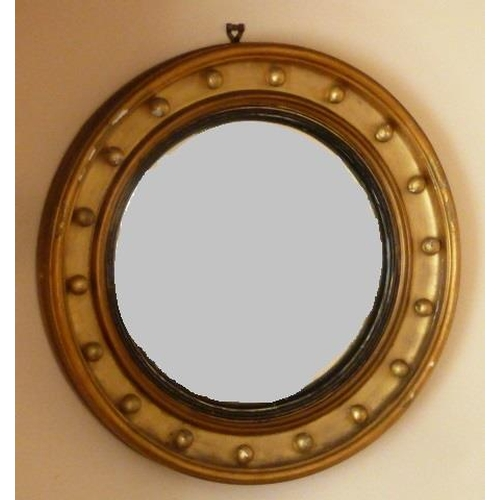 632 - A 19th Century circular gilt framed convex ''bull's eye'' style Looking Glass, (some gilding away), ...