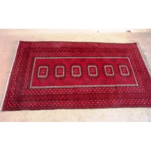 648 - A hand knotted Eastern Carpet, central rectangle with six further rectangle motifs within a three bo...