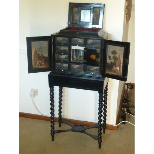 650 - A fine 19th Century (in 17th Century Italianate style) ebonised Cabinet on Stand, the hinged top ope...