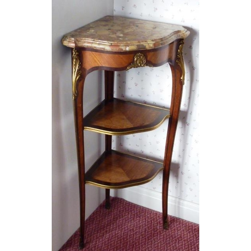 657 - A late 19th Century French marble topped, gilt metal mounted, walnut and rosewood banded Corner Étag...