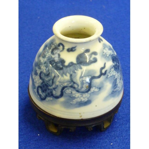 66 - A small Chinese porcelain Water Pot of domed section, the outset circular lip above very fine underg...