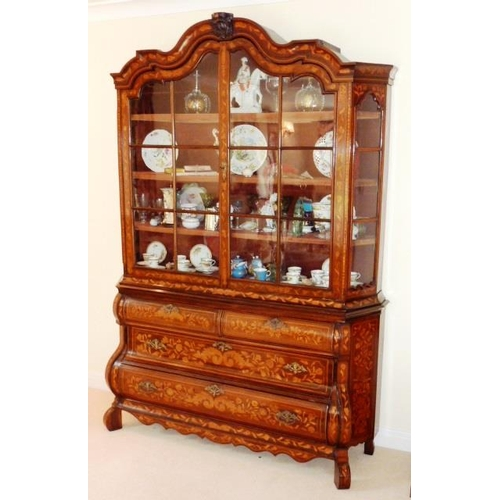 660 - A large early 19th Century Dutch walnut and marquetry Display Cabinet on Chest, the cornice centrall...