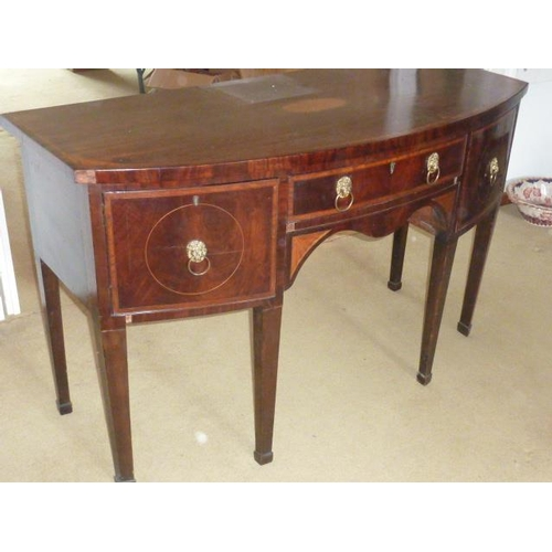 669 - A George III period bow fronted mahogany and satinwood crossbanded Sideboard, the single central ova...