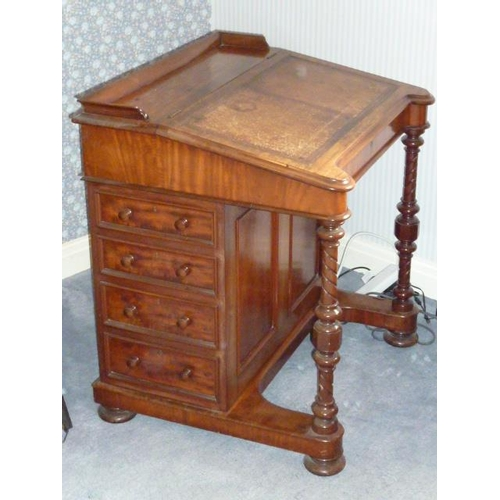 671 - A large mid 19th Century mahogany Davenport Desk, the three quarter galleried top above a sloping le...