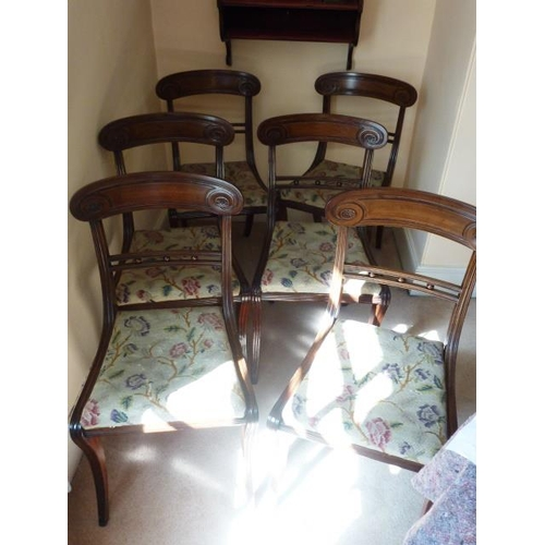 676 - A set of six Regency period mahogany Dining Chairs, each with concave tablet shaped top rail, needle...