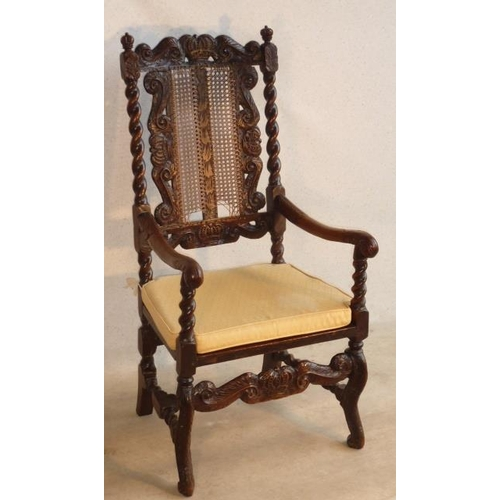 682 - A late 17th Century walnut open Armchair, the top rail carved with a central crown flanked by scroll...