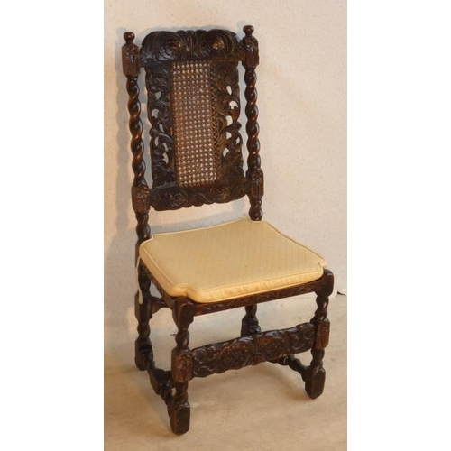 685 - A late 17th Century walnut Side Chair, the top rail with a central vertical leaf motif centring two ...