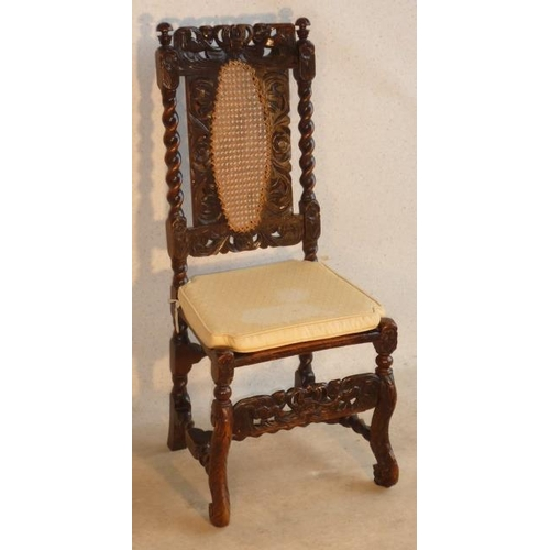 687 - A late 17th Century walnut Side Chair, the top rail with central pierced crown motif held aloft by t...
