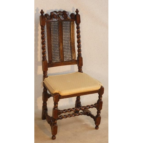688 - A late 17th Century walnut Side Chair, the shaped top rail with a small central flower head above tw...