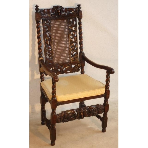 689 - A late 17th Century walnut open Armchair, the top rail centred by a cherubic figure in high relief f...