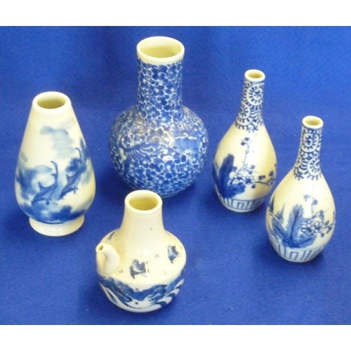 69 - A pair of Oriental Bottle Vases together with one other larger Vase decorated full scale with chrysa...