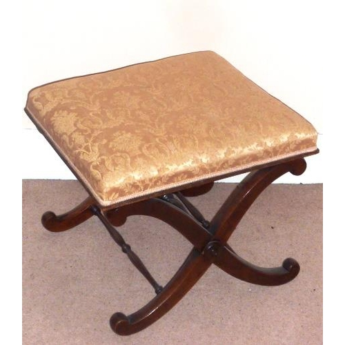691 - A Regency period mahogany cross frame Stool having a later upholstered damask style top (damage)...