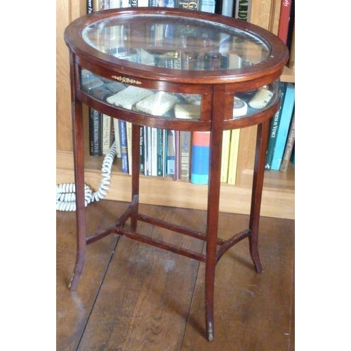 694 - An early 20th Century oval mahogany Bijouterie Table on square tapering slightly splaying legs unite...