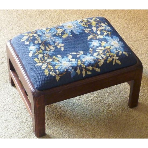 695 - A small George III period mahogany Stool having drop in needlework seat and square moulded legs unit...