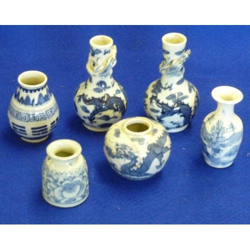 70 - A small pair of Chinese Bottle Vases, each with a Chilong dragon in relief to the neck and decorated...