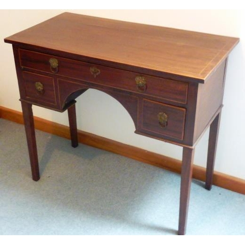 700 - A George III mahogany Side Table, the boxwood strung top above an arrangement of single full width d...