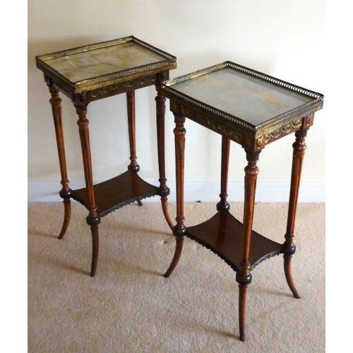 702 - A pair of late 19th Century French marble topped and gilt metal mounted faded mahogany Étagère's, ea...