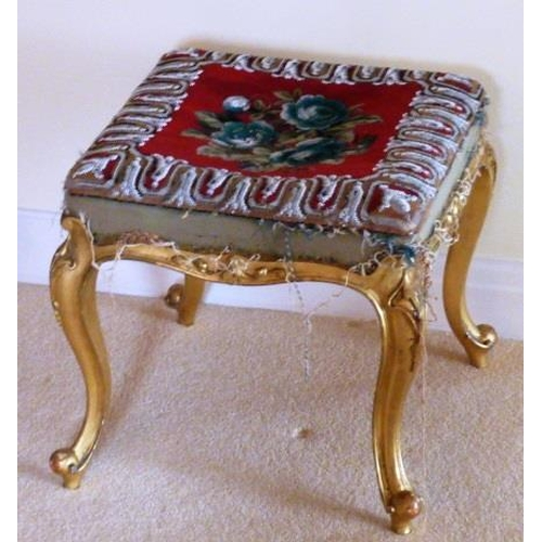 703 - A mid 19th Century giltwood Stool, the elaborate hand stitched beadwork top depicting a central flor...