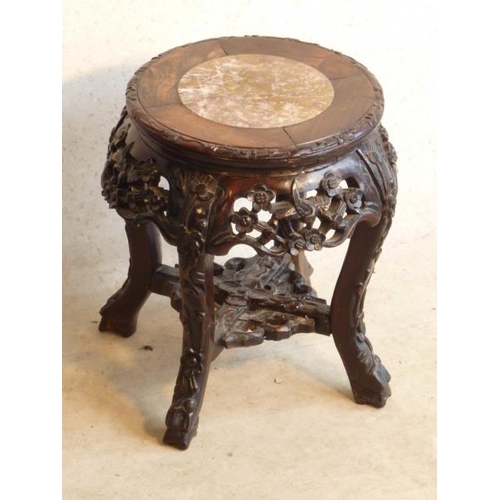 713 - An early 20th Century circular marble inset carved Chinese hardwood Jardinière Stand, pierced border...