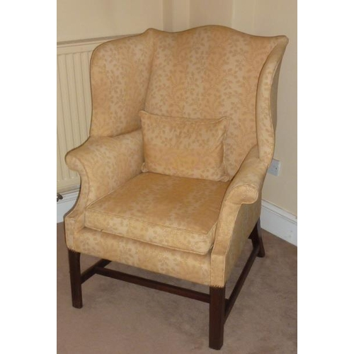 719 - A George III later upholstered and mahogany wing back Armchair, floral damask style yellow upholster...