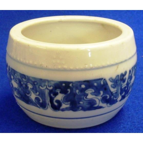 72 - A Chinese porcelain Pot of half barrel form and decorated in underglaze blue with a continuous band ...