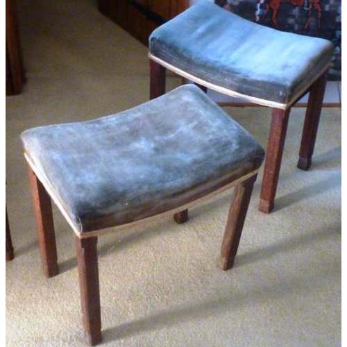 721 - Two George VI oak and upholstered Coronation Stools, upholstered saddle style seats and chamfered le...