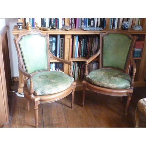 722 - A good pair of Louis XVI style leather upholstered and carved walnut open armed Fauteuil, the shaped...