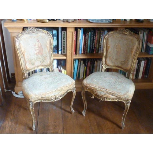723 - A pair of Louis XV style carved giltwood and upholstered Salon Chairs, foliate carved top rails and ...