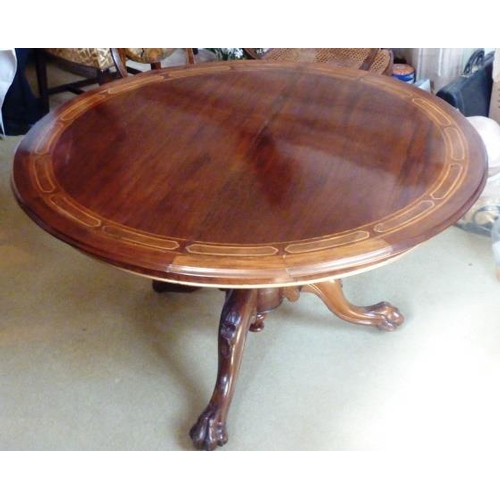 725 - A fine circular mahogany and rosewood inlaid tilt top Centre Table, turned stem and three downswept ...