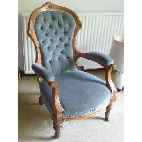 726 - A good 19th Century walnut and upholstered open armed spoon back Armchair on short turned tapering f...