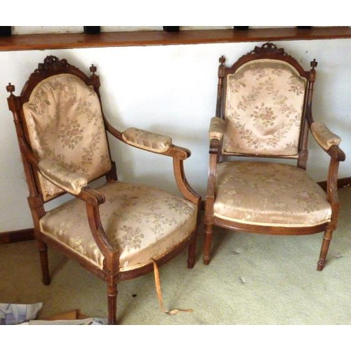 730 - A pair of early 20th C. upholstered and walnut open Armchairs in Louis XVI style, the top rails carv...