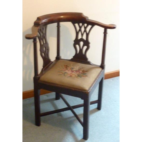 731 - A mid 18th Century mahogany Corner Chair, two pierced splats, drop in floral needlework seat and on ...