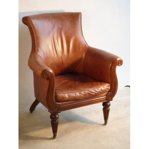 733 - A good reproduction brown leather upholstered and mahogany copy of Napoleon's Armchair, scrolling ar...