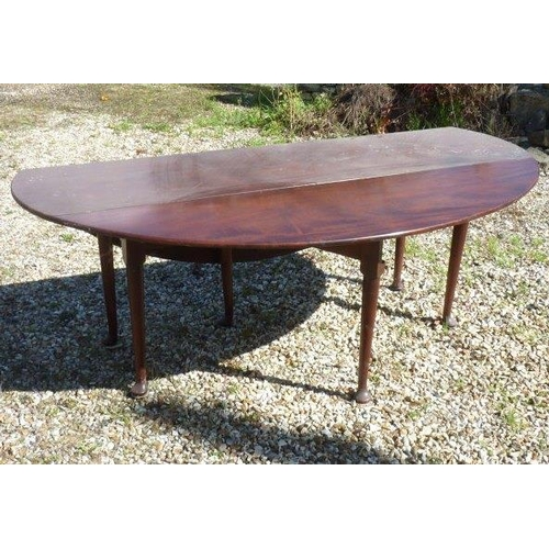740 - A good late 18th Century oval top drop leaf mahogany Wake/Harvest Table raised on turned tapering le...