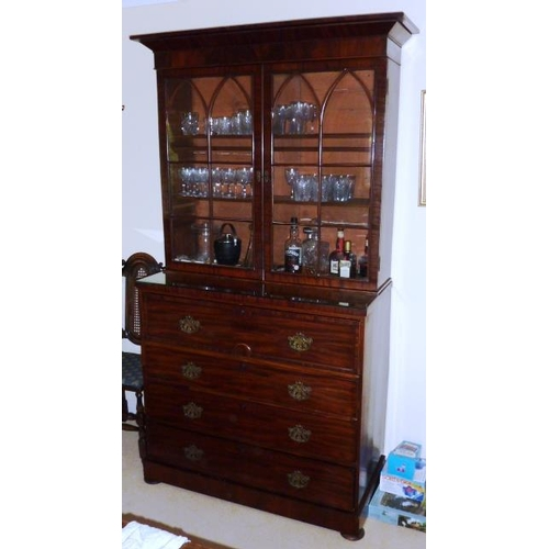 742 - A 19th Century mahogany Bookcase, the flaring cornice above two glazed doors with Gothic style astra...