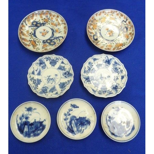 85 - A selection of hand decorated Oriental Saucer Dishes including two 19th Century Japanese Imari examp...