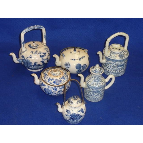89 - An interesting selection of six assorted Chinese ceramic teapots of various sizes and decoration, th...