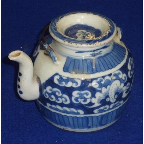 90 - A Chinese porcelain teapot of jar form, the circular cover centrally decorated with a stylised cloud...