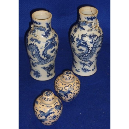 93 - A pair of Chinese porcelain ovoid-shaped Vases, the necks with applied Chilong dragons in relief and...