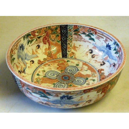 94 - A large and heavy mid 19th Century Japanese porcelain bowl, very finely decorated to both the interi...