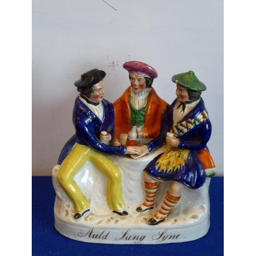 14 - A 19th Century Staffordshire figure group Auld Lang Syne, 20cm high...