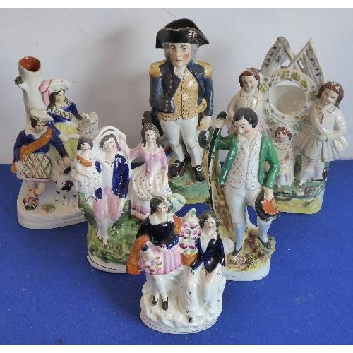 43A - A group of six 19th century Staffordshire flat back figures to include Band of Hope and a Lord Nelso...