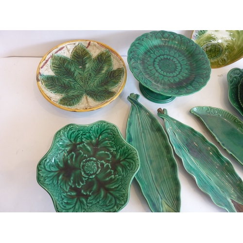 28 - A selection of mostly 19th century green-glaze leaf moulded dishes...