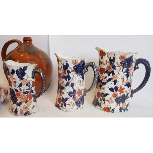 39 - A stoneware flagon with a burnt umber glaze together with a Studio-ware jug and four Imari ware cera...